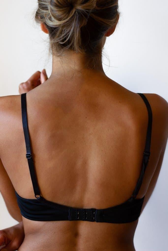 Dark fake tanner results on back